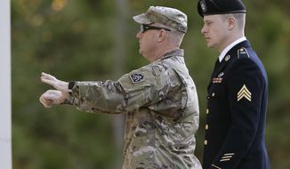 Army Sgt. Bowe Bergdahl, right, arrives at the Fort Bragg courtroom facility for a sentencing hearing at Fort Bragg, N.C., Friday, Nov. 3, 2017. Bergdahl, who walked off his base in Afghanistan in 2009 and was held by the Taliban for five years, pleaded guilty to desertion and misbehavior before the enemy. (AP Photo/Gerry Broome)
