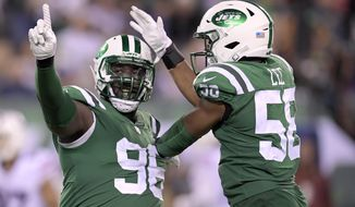 New York Jets defensive end Muhammad Wilkerson (96) and inside linebacker Darron Lee (58) celebrate after a play against the Buffalo Bills during the second half of an NFL football game, Thursday, Nov. 2, 2017, in East Rutherford, N.J. (AP Photo/Bill Kostroun)
