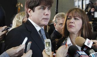 FILE - In this Dec. 7, 2011 file photo, former Illinois Gov. Rod Blagojevich, left, speaks to reporters as his wife, Patti, listens at the federal building in Chicago. The Imprisoned former Gov. has again asked the Supreme Court to toss his corruption convictions, arguing the nation's highest court can finally settle lingering disagreements among lower courts over what constitutes illegal political fundraising. The filing was posted Friday, Nov. 3, 2017. (AP Photo/M. Spencer Green, File)