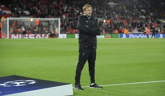 Liverpool manager Juergen Klopp stands on the pitch prior the Champions League Group E soccer match between Liverpool and Maribor at Anfield, Liverpool, England, Wednesday Nov. 1, 2017. (AP Photo/Rui Vieira)