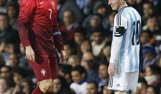 FILE - In this file photo dated Tuesday Nov. 18, 2014, Cristiano Ronaldo of Portugal, left, and Lionel Messi of Argentina, during their International Friendly soccer match at Old Trafford Stadium, Manchester, England. More worldwide soccer tournaments involving even more national teams could be coming to every odd-numbered year from 2021, according to officials of the UEFA-led Global Nations League project, Friday Nov. 3, 2017, which may replace the Confederation Cup, so the worlds best players may face off against each other at last.   (AP Photo/Jon Super, FILE)