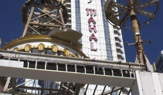This Nov. 3, 2017 photo shows partially dismantled domes and spires at the former Trump Taj Mahal casino in Atlantic City, N.J. The casino that was built by now-President Donald Trump in 1990 is being converted into a Hard Rock casino resort. (AP Photo/Wayne Parry)