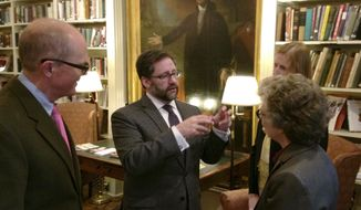 Jon Parrish Peede, center, acting head of the National Endowment for the Humanities, speaks with people from local cultural organizations during a reception, Friday, Nov. 3, 2017, in Providence, R.I. President Donald Trump proposed eliminating arts-related agencies, including the 52-year-old NEH, in his 2018 budget. (AP Photo/Jennifer McDermott)