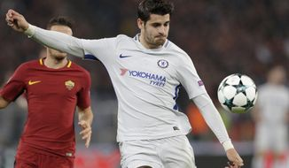 Chelsea's Alvaro Morata goes for the ball during the Champions League group C soccer match between Roma and Chelsea, at the Olympic stadium in Rome, Tuesday, Oct. 31, 2017. (AP Photo/Andrew Medichini)