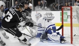 Toronto Maple Leafs goalie Curtis McElhinney, right, gives up a goal to Los Angeles Kings center Tyler Toffoli during the second period of an NHL hockey game, Thursday, Nov. 2, 2017, in Los Angeles. (AP Photo/Mark J. Terrill)