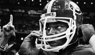 FILE - In this Jan. 1, 1981, file photo, Georgia's Herschel Walker prepares to leave the field after Georgia defeated Notre Dame in the Sugar Bowl NCAA college football game in New Orleans. Well, this might be the team that finally brings reality in line with the lofty expectations between the hedges. In Kirby Smart's second season as coach, Georgia has won its first eight games, all but one by at least three touchdowns, and claimed the No. 1 spot in the first College Football Playoff rankings. (AP Photo/File)