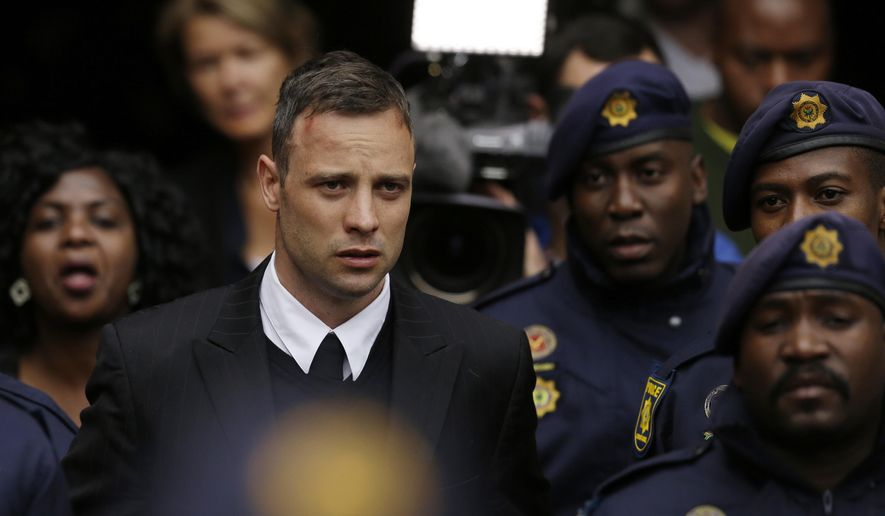 FILE - In this Tuesday, June 14, 2016, file photo, Oscar Pistorius leaves the High Court in Pretoria, South Africa, after his sentencing proceedings. The Pistorius case is back in court, Friday, Nov. 3, 2017, with prosecutors seeking a longer jail sentence for the double-amputee athlete after he was found guilty of murder for shooting his girlfriend, Reeva Steenkamp. (AP Photo/Themba Hadebe, File)