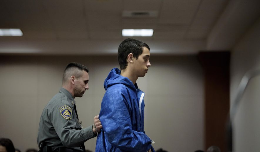 Noah Hendron, 18, is escorted out of New Britain Superior Court after an arraignment in New Britain, Conn., on Friday, Nov. 3, 2017.  Connecticut police say a 16-year-old boy is dead and  Hendron is facing a murder charge after a shooting in Wethersfield.  (Monica Jorge/The Courant via AP, Pool)