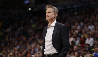 Golden State Warriors head coach Steve Kerr looks on against the Denver Nuggets during the first quarter of an NBA basketball game Saturday, Nov. 4, 2017, in Denver. (Photo by Jack Dempsey)