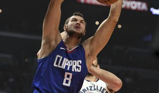 Los Angeles Clippers forward Danilo Gallinari (8) dunks against Memphis Grizzlies center Marc Gasol (33) during the first half of an NBA basketball game, Saturday, Nov. 4, 2017, in Los Angeles. (AP Photo/Michael Owen Baker)
