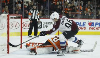 Colorado Avalanche' Mikko Rantanen scores past Philadelphia Flyers' Michal Neuvirth with the winning goal during a shootout in an NHL hockey game, Saturday, Nov. 4, 2017, in Philadelphia. (AP Photo/Tom Mihalek)
