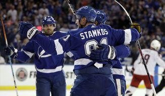 Tampa Bay Lightning center Steven Stamkos (91) celebrates his goal against the Columbus Blue Jackets with teammates, including Alex Killorn (17), during the second period of an NHL hockey game Saturday, Nov. 4, 2017, in Tampa, Fla. (AP Photo/Chris O'Meara)