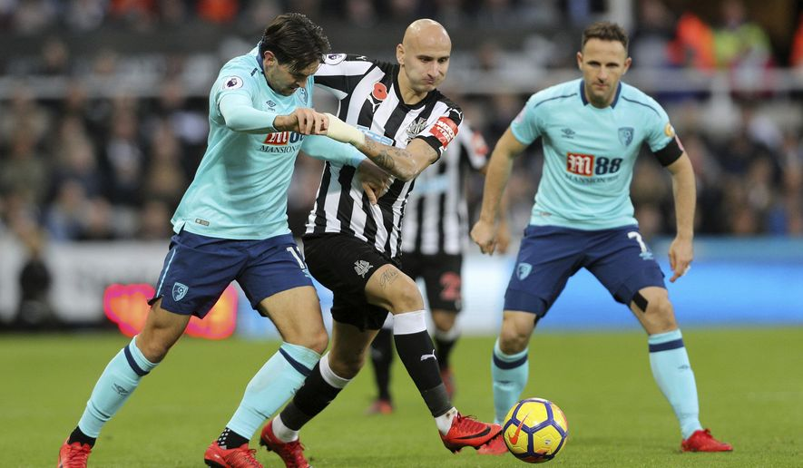 Bournemouth's Charlie Daniels, left, and Newcastle United's Jonjo Shelvey during the English Premier League soccer match against Bournemouth, at St James' Park, Newcastle, Saturday November 4, 2017.   (Owen Humphreys/PA via AP)