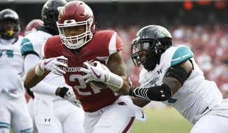 Arkansas running back Devwah Whaley pushes past Costal Carolina defender Eric Church, right, to score a touchdown during the first half of an NCAA college football game Saturday, Nov. 4, 2017, in Fayetteville, Ark. (AP Photo/Michael Woods)
