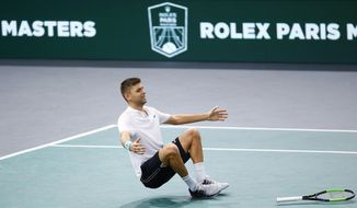 Filip Krajinovic of Serbia celebrates his victory against John Isner of the United States during their semi-final match of the Paris Masters tennis tournament at the Bercy Arena in Paris, France, Saturday, Nov. 4, 2017. (AP Photo/Francois Mori)
