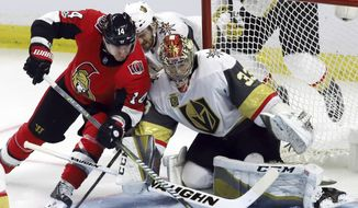Ottawa Senators right wing Alexandre Burrows (14) scores on a backhand against Vegas Golden Knights goalie Maxime Lagace (33) during the second period of an NHL hockey game, Saturday, Nov. 4, 2017 in Ottawa, Ontario. (Fred Chartrand /The Canadian Press via AP)
