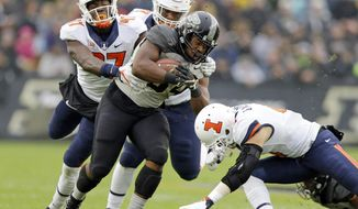 Purdue running back Richie Worship (34) is tackled by Illinois defensive lineman Bobby Roundtree (97) and defensive back Bennett Williams (4) during the first half of an NCAA college football game in West Lafayette, Ind., Saturday, Nov. 4, 2017. (AP Photo/Michael Conroy)