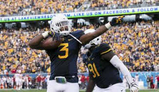 West Virginia's Al-Rasheed Benton (3) celebrates following an interception during the first half of an NCAA college football game against Iowa State in Morgantown, W. Va., Saturday, Nov. 4, 2017. (AP Photo/Walter Scriptunas II)