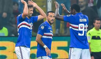 Sampdoria's Gaston Ramirez, left, celebrates with his teammates Fabio Quagliarella, center, and Duvan Zapata after scoring during a Serie A soccer match between Genova and Sampdoria at the Luigi Ferraris stadium in Genoa, Italy, Saturday, Nov. 4, 2017. (Simone Arveda/ANSA via AP)