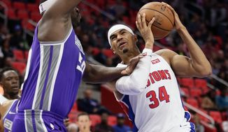 Detroit Pistons forward Tobias Harris (34) goes to the basket against Sacramento Kings forward Zach Randolph (50) during the first half of an NBA basketball game Saturday, Nov. 4, 2017, in Detroit. (AP Photo/Duane Burleson)
