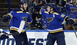 St. Louis Blues' Joel Edmundson, left, is congratulated by St. Louis Blues' Vladimir Tarasenko, of Russia, after scoring during the second period of an NHL hockey game against the Toronto Maple Leafs Saturday, Nov. 4, 2017, in St. Louis. (AP Photo/Jeff Roberson)