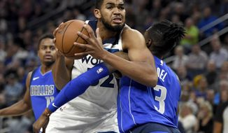 Minnesota Timberwolves center Karl-Anthony Towns (32) fouls Dallas Mavericks center Nerlens Noel (3) during the first quarter of an NBA basketball game on Saturday, Nov. 4, 2017, in Minneapolis. (AP Photo/Hannah Foslien)