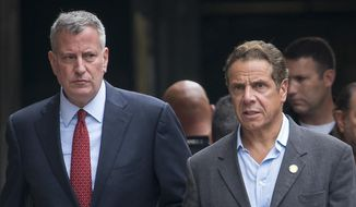In this photo from Sunday, Sept. 18, 2016, New York Mayor Mayor Bill de Blasio, left, and  Gov. Andrew Cuomo walk near the scene of an explosion in Manhattan's Chelsea neighborhood, in New York. (AP Photo/Craig Ruttle, File)