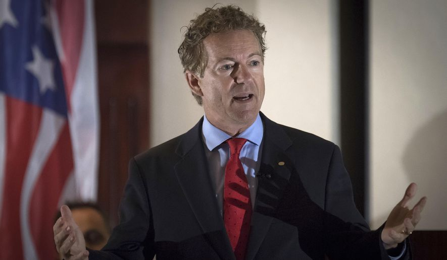In this Aug. 11, 2017, photo, Sen. Rand Paul, R-Ky., speaks to supporters in Hebron, Ky. (AP Photo/Bryan Woolston, file)