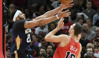 New Orleans Pelicans forward Anthony Davis (23) and Chicago Bulls forward Paul Zipser (16) go for the ball during the first half of an NBA basketball game, Saturday, Nov. 4, 2017, in Chicago. (AP Photo/David Banks)