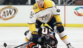 Nashville Predators center Ryan Johansen, above, bowls over Anaheim Ducks center Antoine Vermette, below, to get to the puck during the first period of an NHL hockey game in Anaheim, Calif., Friday, Nov. 3, 2017. (AP Photo/Alex Gallardo)