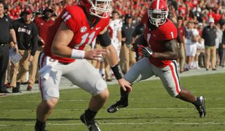 Georgia running back Sony Michel (1) runs for a touchdown against South Carolina with blocking from quarterback Jake Fromm (11) during an NCAA college football game Saturday, Nov. 4, 2017, in Athens, Ga. (Bob Andres/Atlanta Journal Constitution via AP)