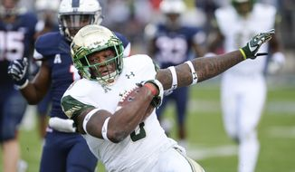 South Florida wide receiver Tyre McCants (8) gains yardage during the first half of an NCAA college football game, Saturday, Nov. 4, 2017, in East Hartford, Conn. (AP Photo/Stephen Dunn)