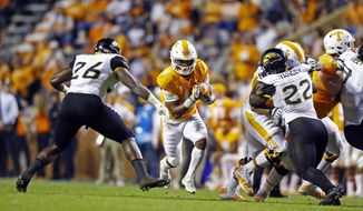 Tennessee running back John Kelly (4) runs for yardage as he's defended by Southern Mississippi linebacker Jeremy Sangster (26) in the first half of an NCAA college football game Saturday, Nov. 4, 2017, in Knoxville, Tenn. (AP Photo/Wade Payne)