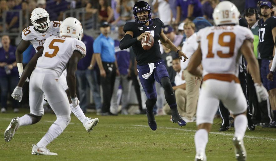 TCU quarterback Kenny Hill (7) runs for a first down as Texas defenders Holton Hill (5) and Brandon Jones (19) close in during the first half of an NCAA college football game Saturday, Nov. 4, 2017, in Fort Worth, Texas. (AP Photo/Ron Jenkins)