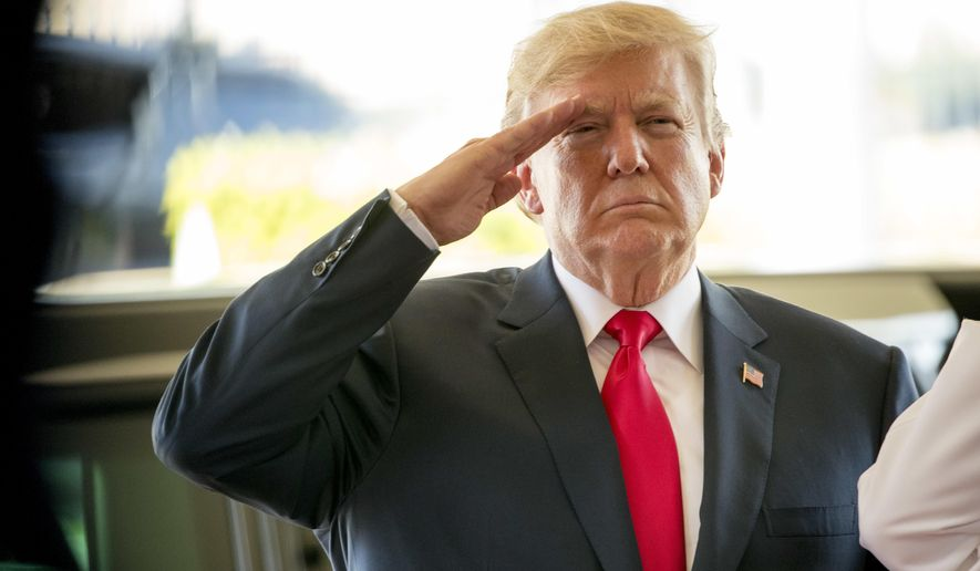 President Donald Trump salutes during a welcome ceremony at U.S. Pacific Command (PACOM), Friday, Nov. 3, 2017, in Aiea, Hawaii. Trump begins a 5 country trip through Asia traveling to Japan, South Korea, China, Vietnam and the Philippians. (AP Photo/Andrew Harnik)