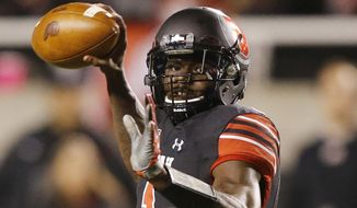 Utah quarterback Tyler Huntley prepares to throw a pass during the first half of an NCAA college football game against UCLA on Friday, Nov. 3, 2017, in Salt Lake City. (AP Photo/Rick Bowmer)