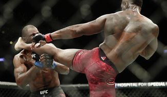 Ovince Saint Preux, right, kicks Corey Anderson during a light heavyweight mixed martial arts bout at UFC 217 Saturday, Nov. 4, 2017, in New York. Saint Preux won the fight. (AP Photo/Frank Franklin II)
