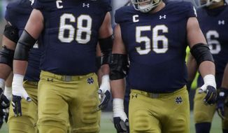 Notre Dame offensive line Mike McGlinchey (68) talks with offensive line Quentin Nelson (56) during the first half of an NCAA college football game against Wake Forest, Saturday, Nov. 4, 2017, in South Bend, Ind. (AP Photo/Nam Y. Huh)