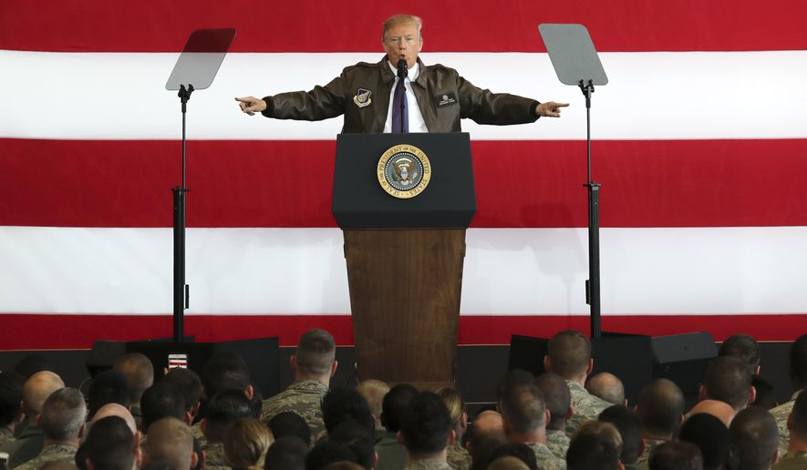 Meeting with U.S. troops at Yokota Air Base in Japan on the first full day of his Asia visit, President Trump referred to the diplomatic and security challenges posed by North Korea's nuclear weapons and missile programs. (Associated Press)