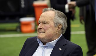 Former president George H.W. Bush arrives for an NFL football game between the Houston Texans and the Indianapolis Colts, Sunday, Nov. 5, 2017, in Houston. (AP Photo/David J. Phillip)