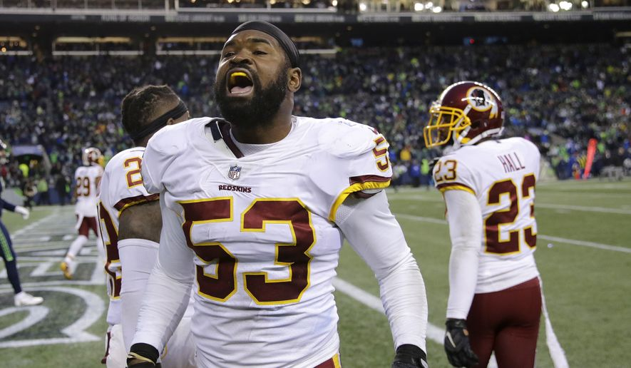Washington Redskins inside linebacker Zach Brown celebrates a play in the second half of an NFL football game against the Seattle Seahawks, Sunday, Nov. 5, 2017, in Seattle. (AP Photo/Stephen Brashear) ** FILE **
