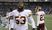 Washington Redskins inside linebacker Zach Brown celebrates a play in the second half of an NFL football game against the Seattle Seahawks, Sunday, Nov. 5, 2017, in Seattle. (AP Photo/Stephen Brashear)