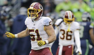 Washington Redskins inside linebacker Will Compton celebrates after he intercepted a pass in the second half of an NFL football game against the Seattle Seahawks, Sunday, Nov. 5, 2017, in Seattle. (AP Photo/Stephen Brashear) **FILE**