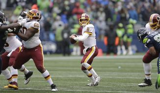Washington Redskins quarterback Kirk Cousins looks to pass in the first half of an NFL football game against the Seattle Seahawks, Sunday, Nov. 5, 2017, in Seattle. (AP Photo/Stephen Brashear)