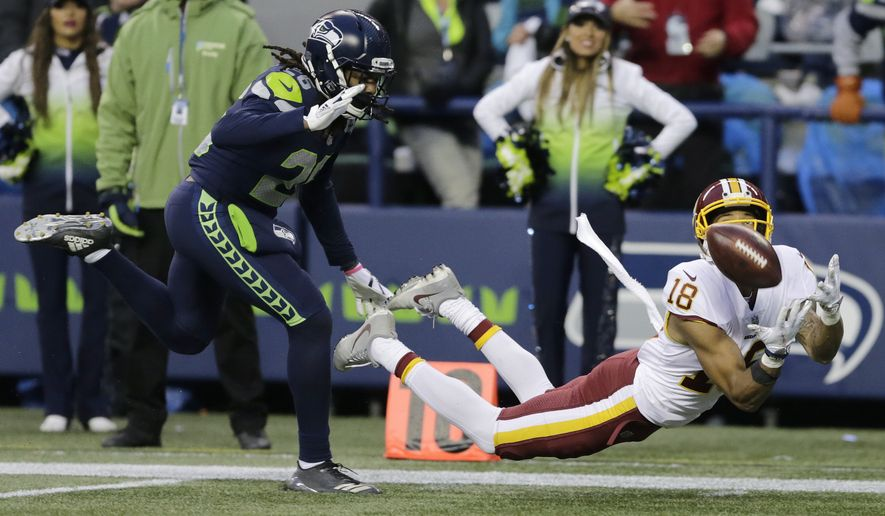 Washington Redskins wide receiver Josh Doctson, right, makes a diving catch ahead of Seattle Seahawks cornerback Shaquill Griffin, left, in the second half of an NFL football game, Sunday, Nov. 5, 2017, in Seattle. The Redskins won 17-14. (AP Photo/Stephen Brashear)