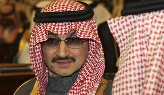 "In this Sunday, March 7, 2010, file photo, Saudi billionaire Prince Alwaleed bin Talal al-Saud attends the speech of King Abdullah bin Abdul Aziz al-Saud of Saudi Arabia, at the Saudi Shura ""consultative"" council in Riyadh, Saudi Arabia. A high-level employee at Prince Alwaleed bin Talal's Kingdom Holding Company told The Associated Press that the royal was among those detained overnight Saturday, Nov. 4, 2017. (AP Photo/Hassan Ammar, File)"