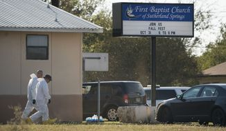 Members of the FBI walk next to the First Baptist Church of Sutherland Springs after a fatal shooting, Sunday, Nov. 5, 2017, in Sutherland Springs, Texas. (AP Photo/Darren Abate)