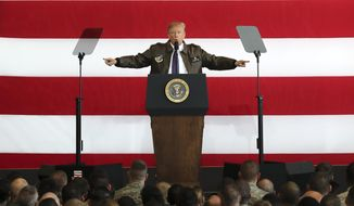 U.S. President Donald Trump delivers a speech for the U.S. troops at the U.S. Yokota Air Base, on the outskirts of Tokyo, Sunday, Nov. 5, 2017.  President Trump arrived in Japan Sunday on a five-nation trip to Asia, his second extended foreign trip since taking office and his first to Asia. The trip will take him to Japan, South Korea, China, Vietnam and Philippines for summits of the Asia-Pacific Economic Cooperation (APEC) and the Association of Southeast Asian Nations (ASEAN). (AP Photo/Eugene Hoshiko)