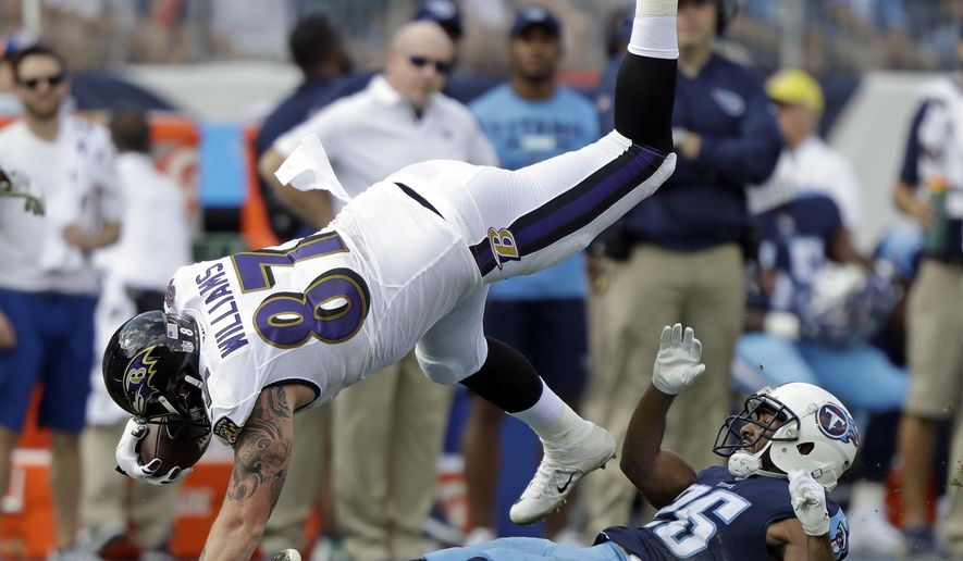Baltimore Ravens tight end Maxx Williams (87) is tripped up by Tennessee Titans defensive back Logan Ryan (26) in the first half of an NFL football game Sunday, Nov. 5, 2017, in Nashville, Tenn. (AP Photo/Wade Payne)