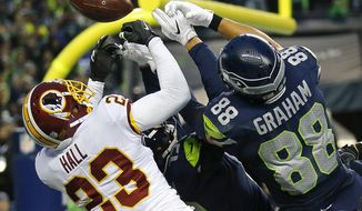 Washington Redskins free safety DeAngelo Hall (23) breaks up a pass in the end zone intended for Seattle Seahawks tight end Jimmy Graham (88) at the end of an NFL football game, Sunday, Nov. 5, 2017, in Seattle. Washington won 17-14. (AP Photo/Stephen Brashear)